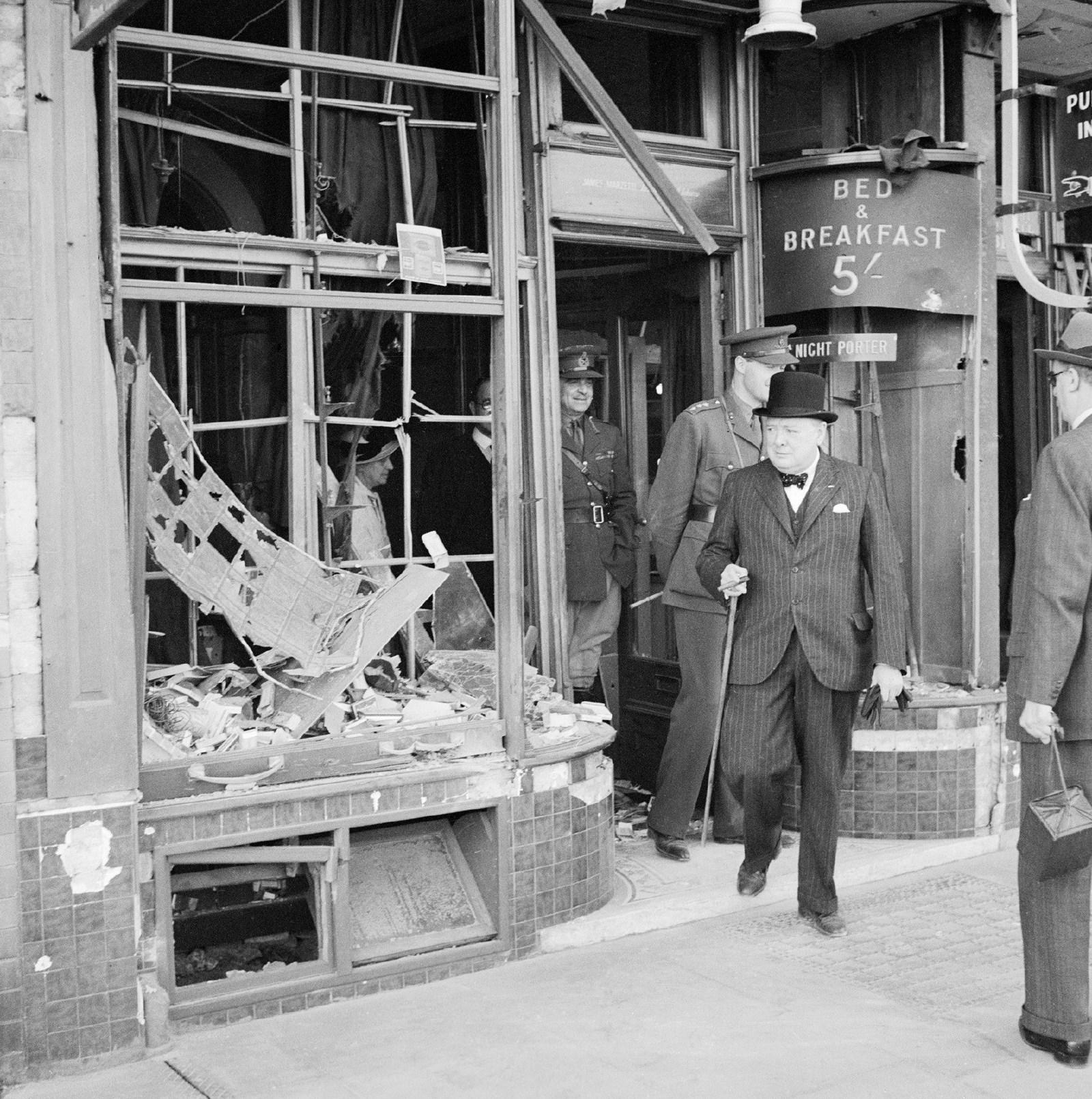 Churchill inspects air raid damage in August 1940