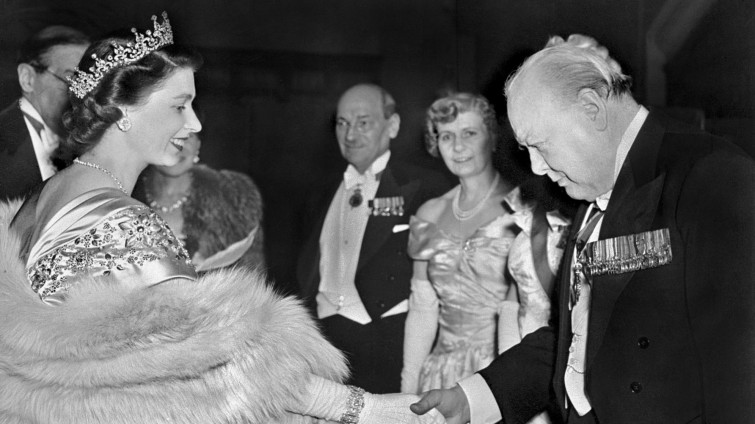 Churchill greets the Queen, while Clement Attlee and his wife Violet look on